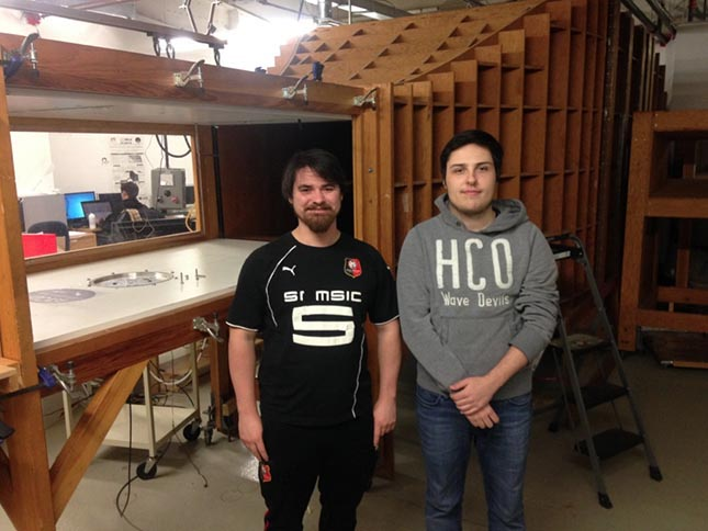 Picture of David Communier, PhD student and Antoine Machetto, Bachelor's in Engineering student, in front of the wind tunnel test section chamber