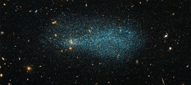 Fig.1 - A new image by the NASA/ESA Hubble Space Telescope of dwarf galaxy ESO 540-31 set against a background of distant galaxies. ESO 540-31 lies just over 11 million light-years from Earth, in the constellation of Cetus (The Whale). Source [Img1].