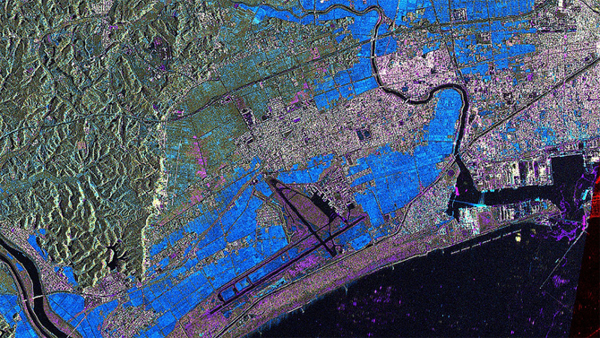 Aerial view of the tsunami disaster: taken in March 2011 by the German TerraSAR-X Earth-observation satellite, this radar image illustrates the impact of the tsunami on the east coast of Japan. The image shows the Higashi-Matsushima airport and the port of Ishinomaki in the Sendai prefecture. Areas marked blue have been flooded while regions where the infrastructure has been destroyed are magenta-coloured. (Source Flickr - CC License]