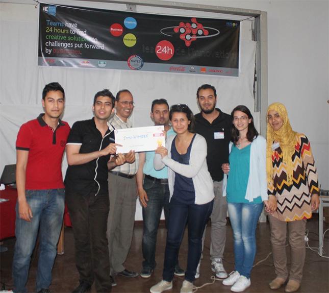 L'équipe gagnante (Edition 27 - 28 mai 2014) composée de : Ghassen Ex, Anis Fadhloun, Manelle Rebhi, Wajd Wr, Shems Bertegi et Abir Hamrouni avec le professeur Maher Lazreg.