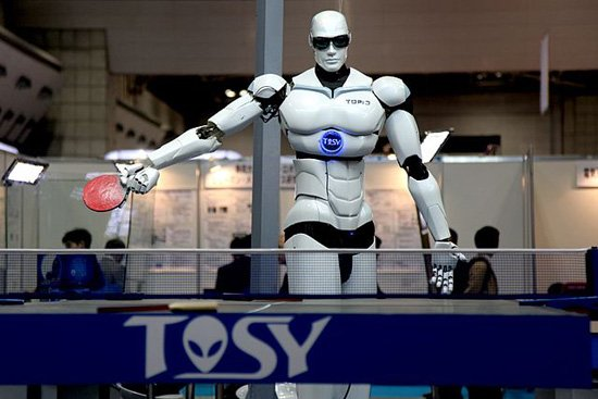 """TOPIO (""""TOSY Ping Pong Playing Robot"""") is a bipedal humanoid robot designed to play table tennis against a human being. Soource [Img1]"""