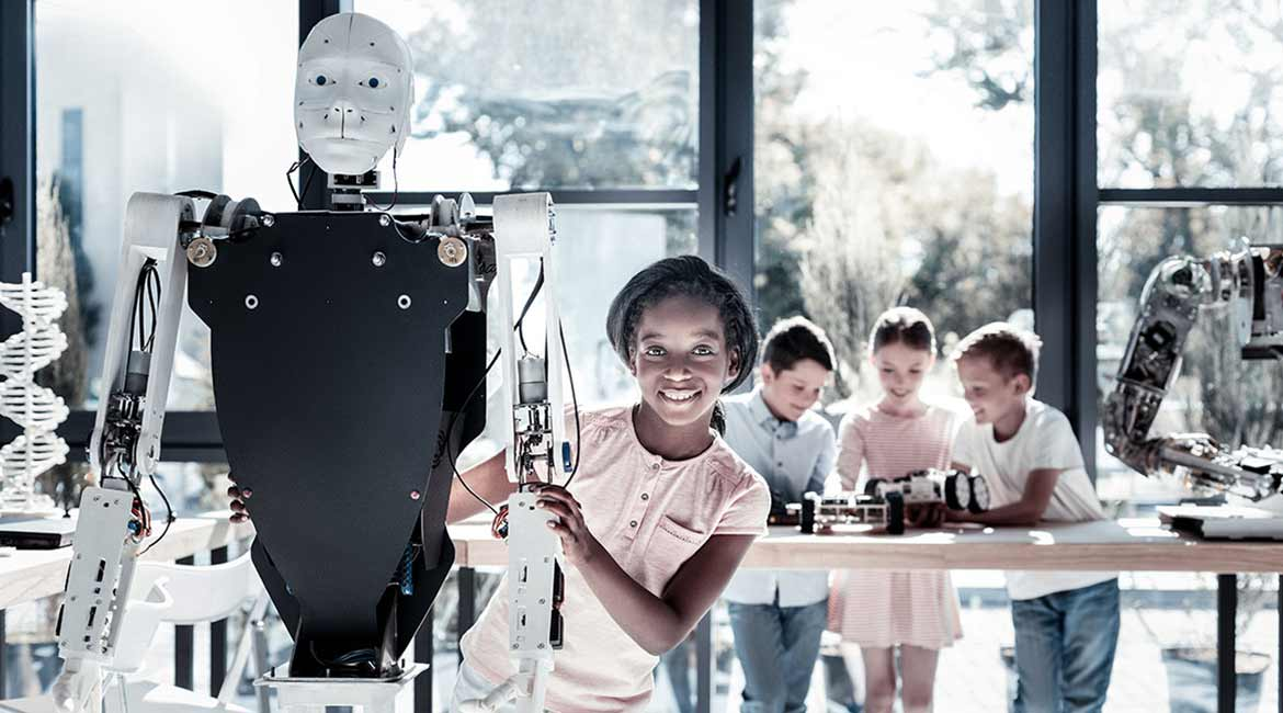 Young girl making robots