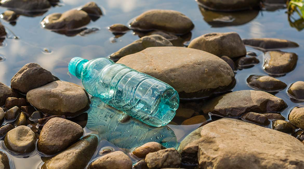 Plastic bottle polluting the water