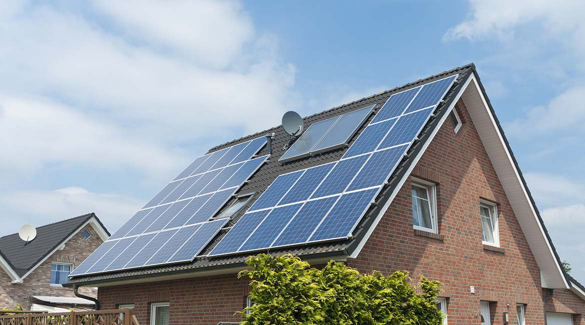 Photovoltaic solar collectors on the roof of a house