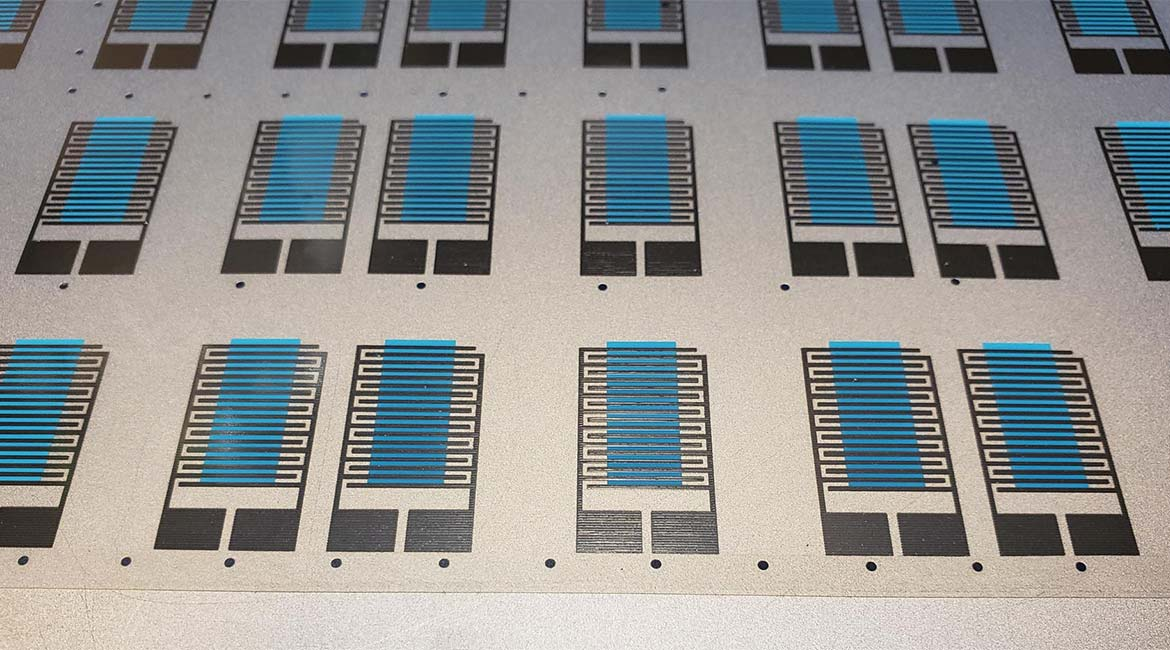 Conductive silver electrodes and active sensing material (blue) printed on flexible substrate