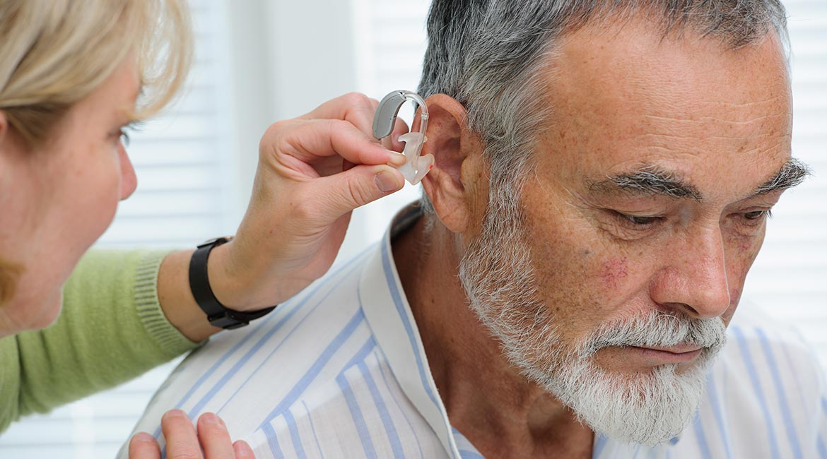 Man reluctant to wear a hearing aid