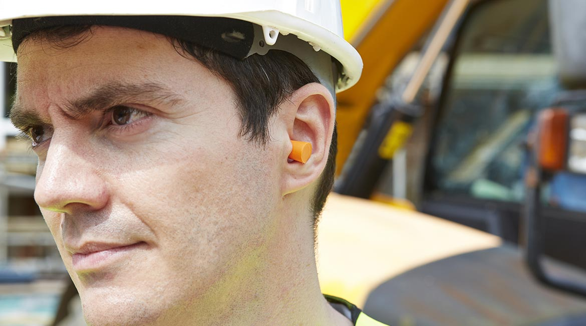 Worker with earplugs